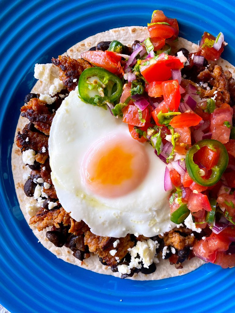 Huevos Rancheros on a blue plate