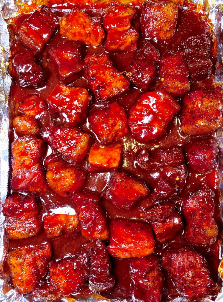 pork belly cubes in bbq sauce in a tray